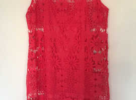 Ladies red lacy dress with matching underslip.
