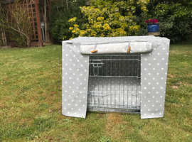 Beautiful, never-used dog crate with cover and cushion
