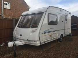 Bargain Sterling Eccles Amber L shape 2 Berth Caravan 2004 V.G.C. With Air Awning,