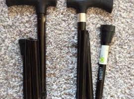 2x fold away walking sticks