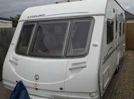 Fixed double bed 4 berth van
