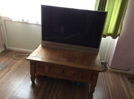 Large tv sold with wooden tv table