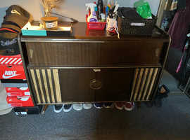 Vintage music radio and vinyl player with cupboard