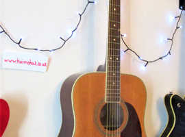 A nicely matured VINTAGE Acoustic Model V400N.  Cleaned, Set-Up with Quality New Strings