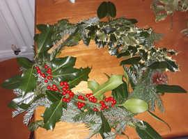 Christmas wreaths,aloe vera plants,and smudge sticks..