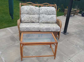 Cane sofa and table