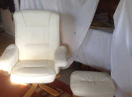 Two cream swivel & reclining armchair with stools.