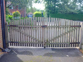 A pair wooden gates made from pressure treated timber