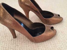 076f4947698f Kurt Geiger bronze metallic peep toe heels in size 4