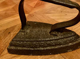 Old Solid IRON they make great doorstops .