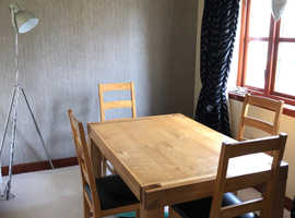 Solid oak extending table and chairs