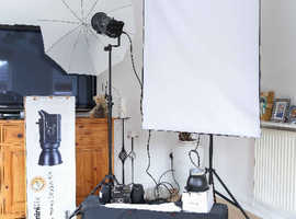 Studio lighting plus portable and fixed  backdrop stands and stools.