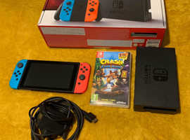 Nintendo Switch boxed with games