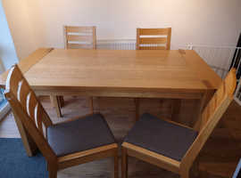 Solid Oak dining table and four chairs £175 ono
