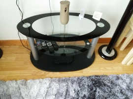 Nice Oval Black/Glass  Table or T.V. Stand