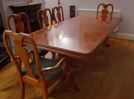 Large extendable wooden dining table and 8 chairs