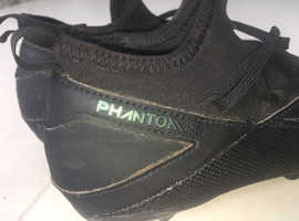 Black unisex used football boots- good condition