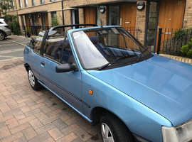 A superb fun French convertible Peugeot 205 CJ 1.4cc 5 speed 1990 excellent drive, ready for summer.