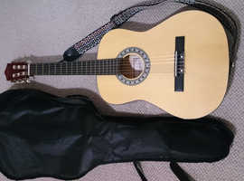 Junior half size guitar with sleeve and sling, as new