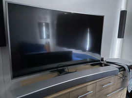 TV   WITH.  SOUND BAR