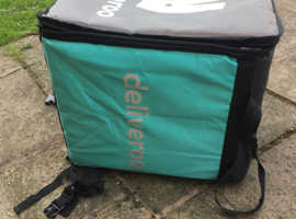 DELIVEROO boxes and jacket.