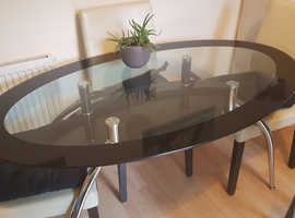 Glass table with white chairs