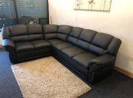 Large black leather corner sofa bed with bedding storage