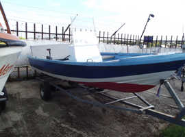 """Fishing / Speed Boat for sale 17' x 5' 6"""" approx. with a 55 hp long shaft engine"""