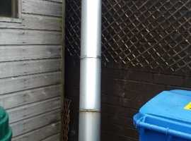 4 inch OIL HEATING FLUE WITH RAIN CAP STILL ATTACHED