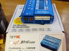 iMax B6 / SkyRC mini Professional Balance Charger / Discharger and SkyRC AC Adapter plus cables.