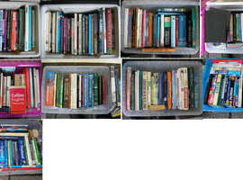 9 Plastic boxes of factual books as seen in photo image.