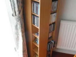 Revolving CD/DVD storage unit
