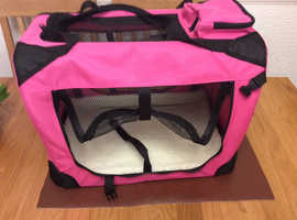 Small portable dog or cat crate.