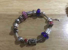 Genuine Pandora bracelet with 15 genuine Pandora charms