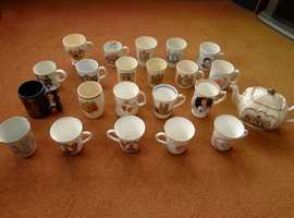 Collection of commemorative mugs,beakers and teapot