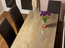 Beautiful Italian marble dining table sits 6