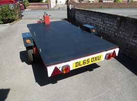 UTILITY FLATBED CAR TRAILER WITH WINCH AND WHEEL LOCK