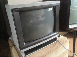 1980s Television with remote good working order. Perfect for Retro Gaming