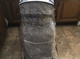 Childs buggy with foot muff and rain cover