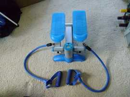 Step machine, with elastic hand straps.