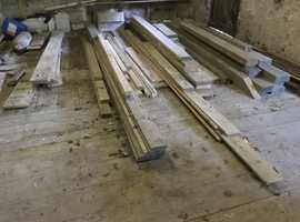 A quantity of unused timber left over from building projects, various sizes