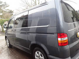 VW T5 Transporter 2008 reg, Surf/day van. Combi style, side windows with 'rock 'n' roll style bed included.