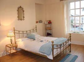 Room to rent in a shared professional house.