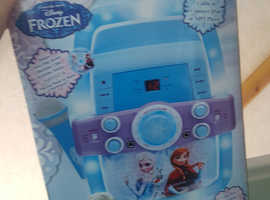 Frozen karaoke machine, frozen castle and guitar