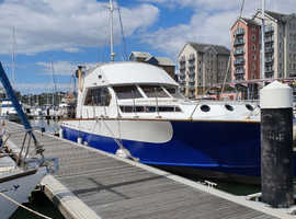Souter 50 Flybridge live aboard boat, Leisure mooring available.