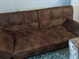 Like new 2 months old brown leather sofa bed