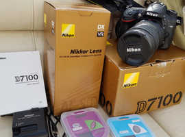 Nikon d7100 DSLR plus Nikon 18-200mm Lens