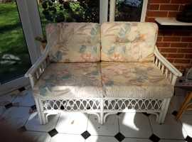 Pretty Three piece conservatory furniture set comprising 2 seater sofa and two single chairs.