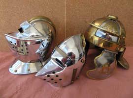 3 Miniature steel and brass helmets.