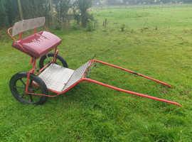 Red pony cart
